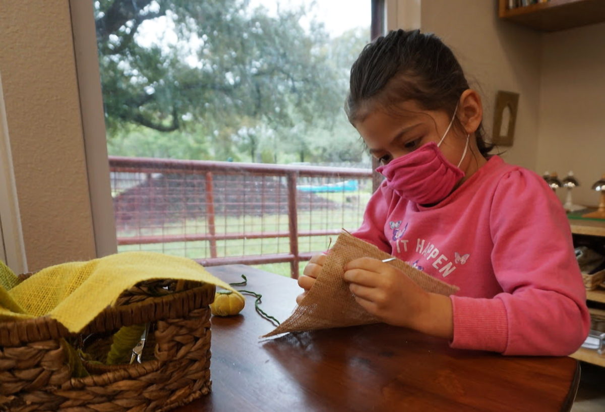 young girl working on an art project