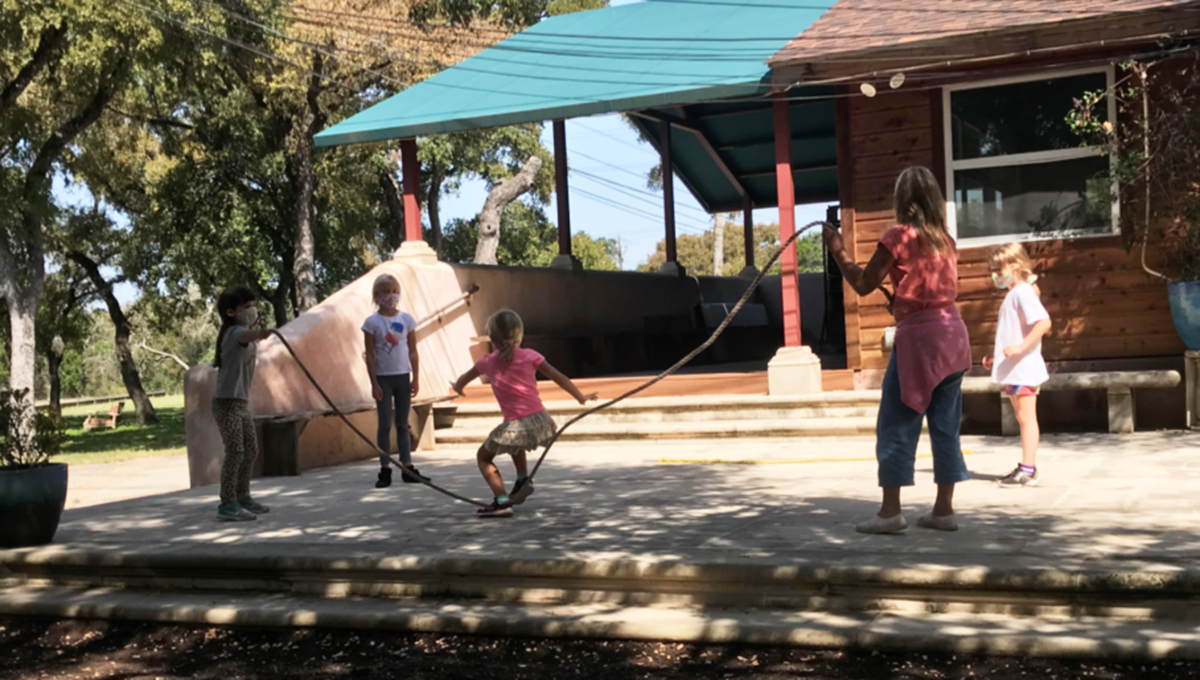 children playing jumprope on the playground